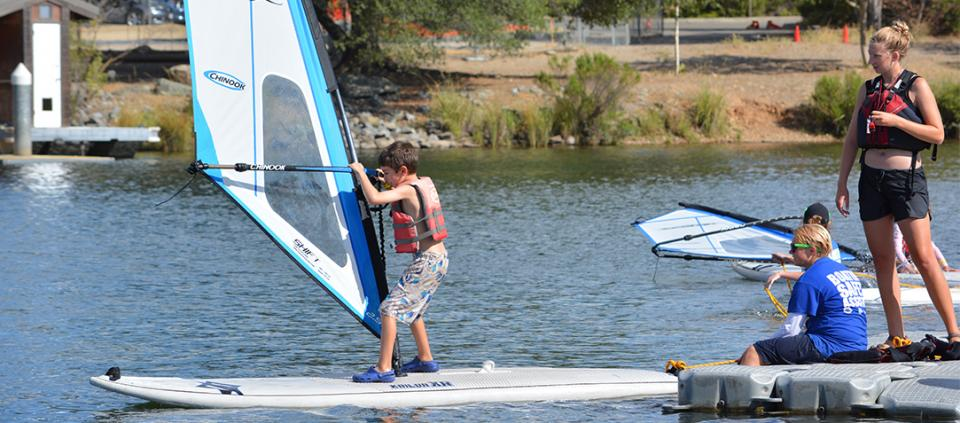 a young boy windsurfing
