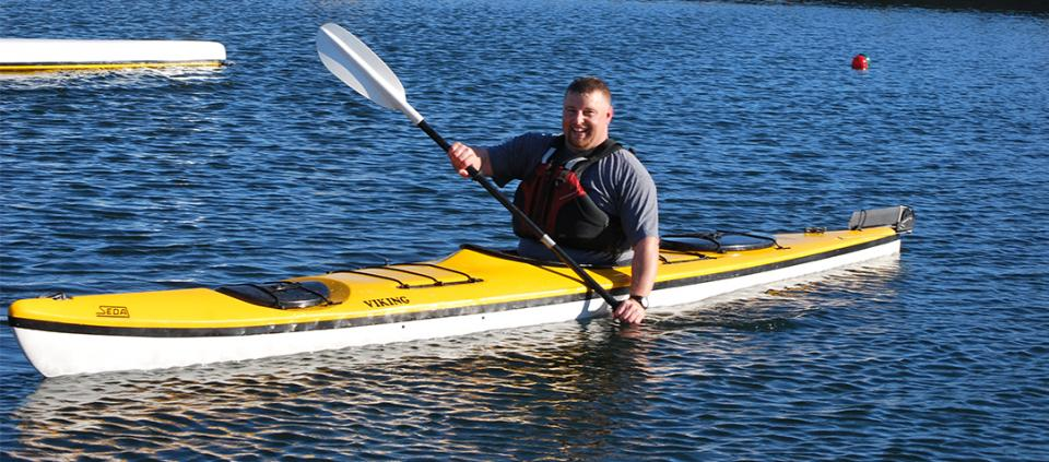 smiling man kayaking