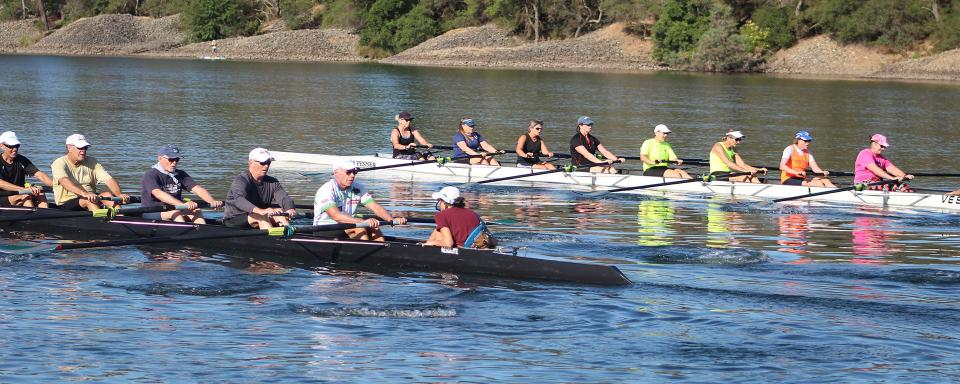 two eight person rowing shells on lake natoma