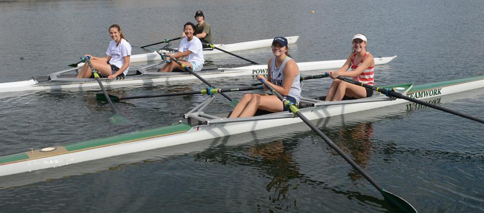 group of rowers smiling
