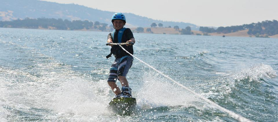 boy wakeboarding on the water