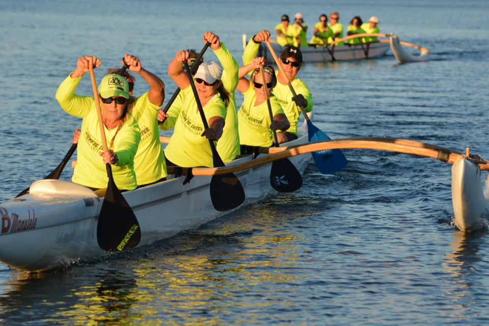 people in an outrigger canoe