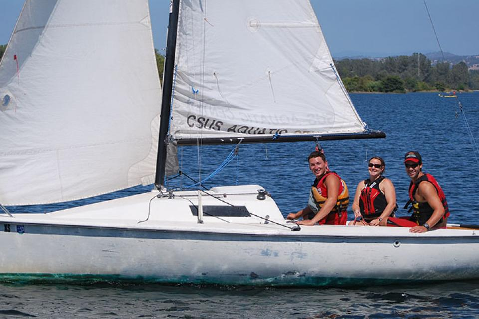 sailboat with smiling sailors