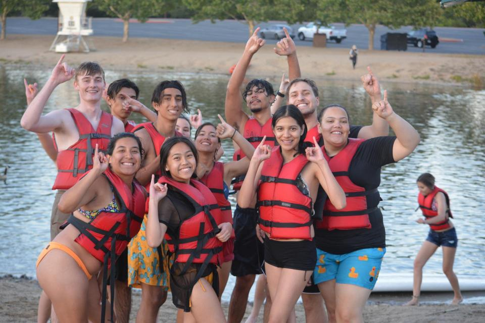 Sac State students on the beach at Lake Natoma